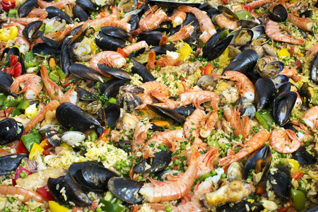 marisco: Paella with Shrimp and Clams close up background Stock Photo