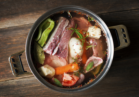 meat soup: fresh beef soup ingredients in large pot Stock Photo