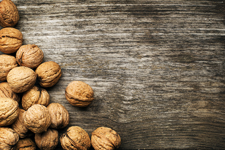 Whole nuts on a wooden background photo
