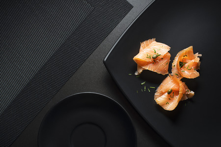 salmon filet: Pieces of fresh smoked salmon served on a plate