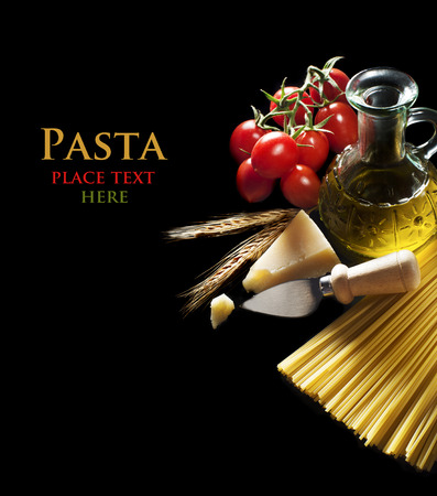 Spaghetti and tomatoes with parmesan cheese on black background