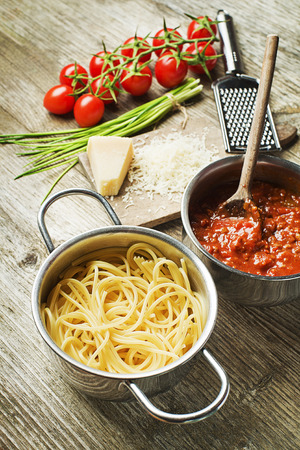 Spaghetti and bolognese sauce with parmesan cheese photo
