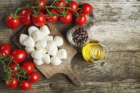 mozzarella cheese: Mozzarella Cheese with Tomatoes and olive oil Stock Photo