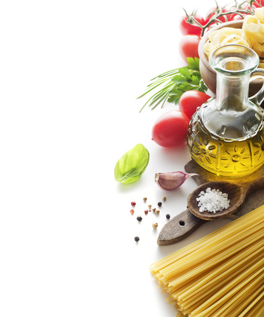 Raw Pasta with ingredients isolated on white background