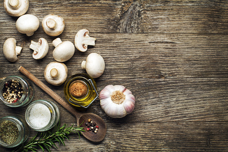 Ingredients with fresh mushrooms on wooden background Banco de Imagens