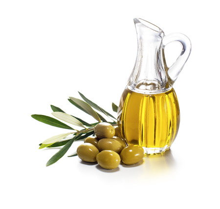 plant oil: Olive oil and olive branch on white background Stock Photo