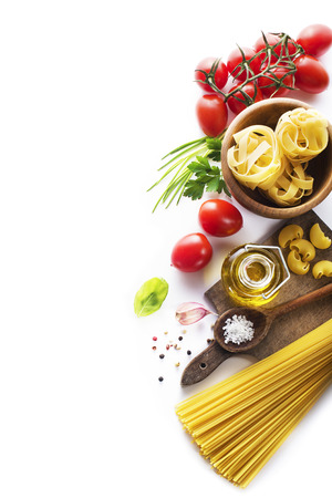 Raw Pasta with ingredients on white background