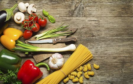 Pasta with Vegetables ingredients on old wooden table photo