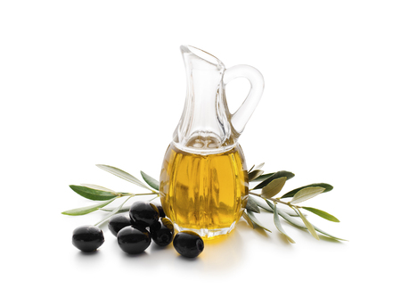black olive: Olive oil and olive branch isolated on white