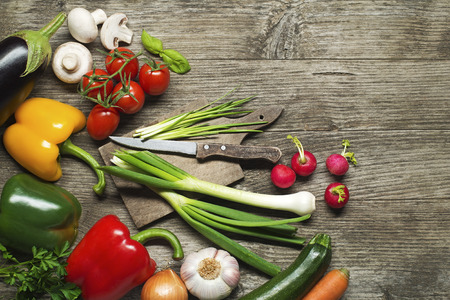 Fresh Vegetable ingredients on old wooden table photo