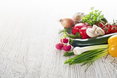 Vegetables on white wooden background close up Archivio Fotografico