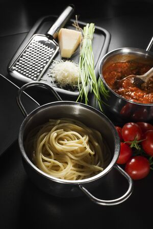 Pasta with bolognese sauce and parmesan cheese photo