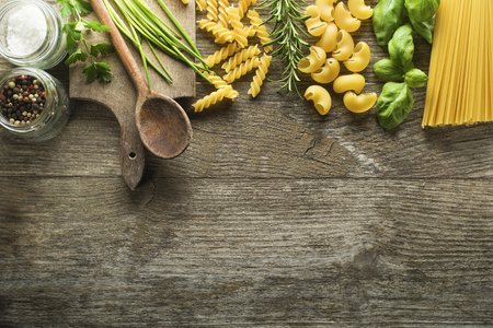spices: Pasta collection with herbs and spices on rustic wooden background