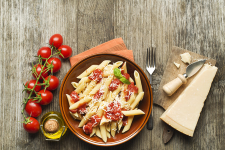 penne: Plate of penne pasta with tomato sauce and parmesan cheese