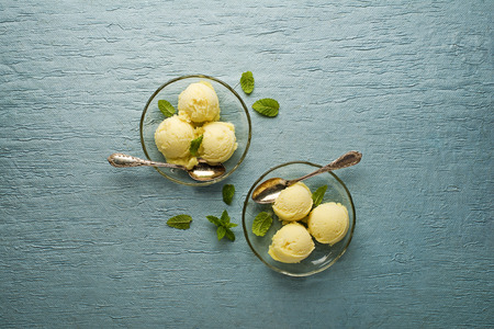 mangoes: Fresh fruit sorbet ice cream in a glass plate - overhead shots.
