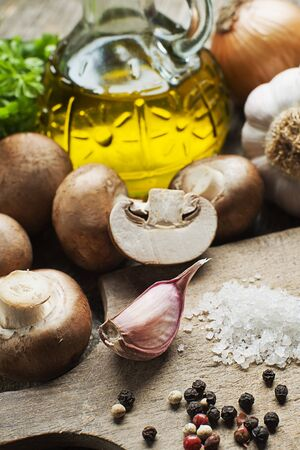 champignons: Ingredients with fresh mushrooms- champignons close up
