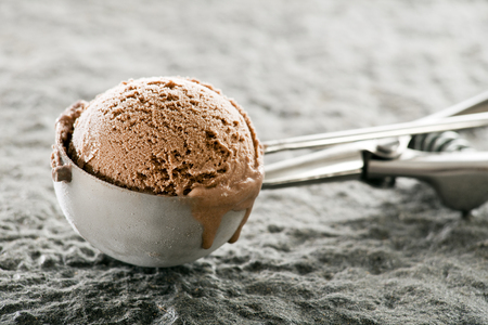 Fresh chocolate ice cream sorbet scoop close up.