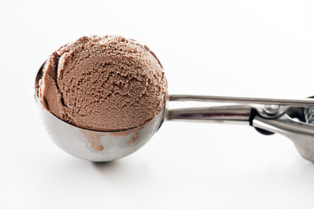Fresh chocolate ice cream scoop close up. Banco de Imagens
