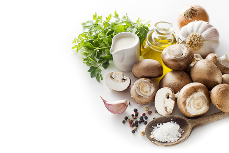 Ingredients with fresh mushrooms on a white background.