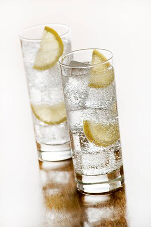 seltzer: Fresh Mineral water with ice and lemon. Stock Photo