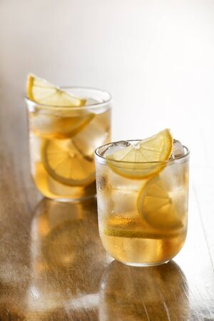 ice tea: Glass of ice tea with lemon and ice cubes.