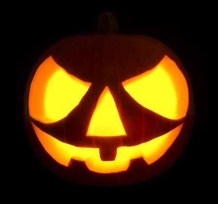 hollows: Halloween pumpkin jack-o-lantern on black dark background.