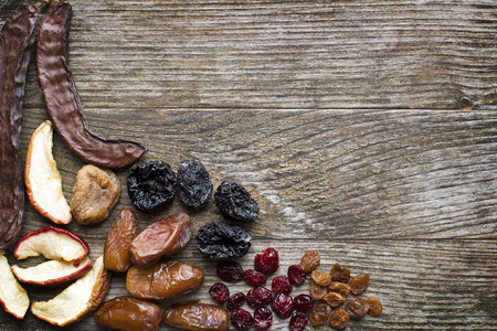 dried: Organic Healthy Assorted Dried Fruit on a wooden background.