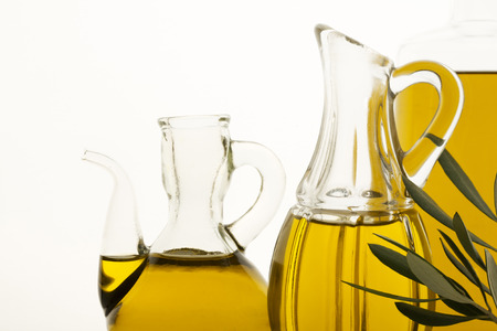cooking oil: Olive oil in the bottles on white background.
