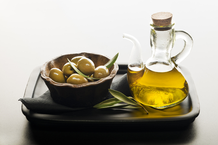 additional: Bottle of premium virgin olive oil and some olives with leaves.