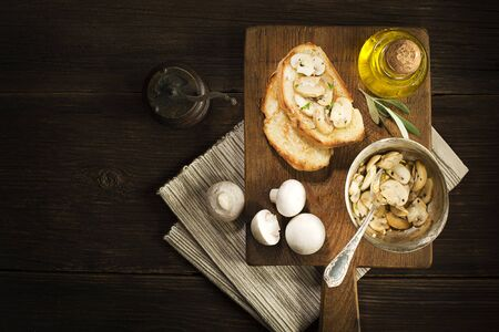cooking oil: Appetizer Bruschetta with sauce of olive oil, mushrooms and herbs.