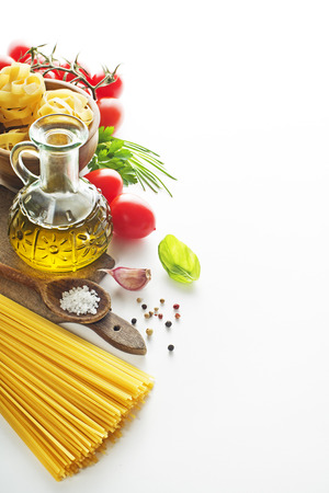 Raw Pasta with ingredients on white background.