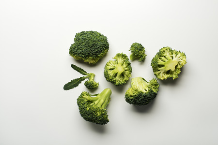 Fresh raw broccoli isolated on a white background.