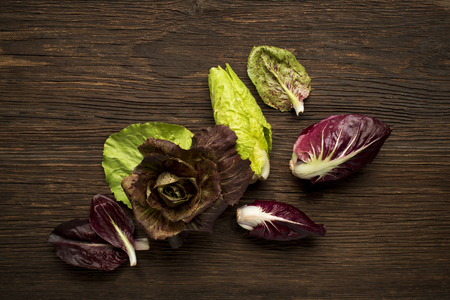 radicchio: Fresh mixed radicchio on a wooden background.