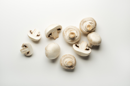 Fresh mushrooms champignons isolated on a white background.