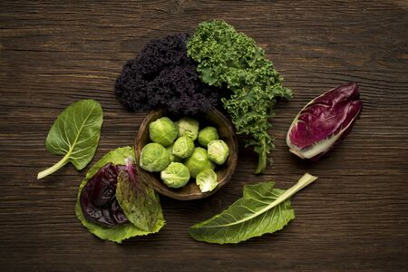 radicchio: Brussels sprouts, kale, chard and radicchio vegetables on wooden background Stock Photo