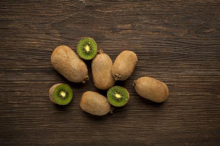 kiwi: Kiwi fruits on wooden background overhead shoots.