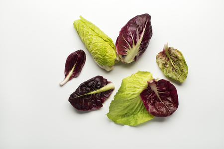 radicchio: Fresh mixed salad leaves with radicchio on a white background.