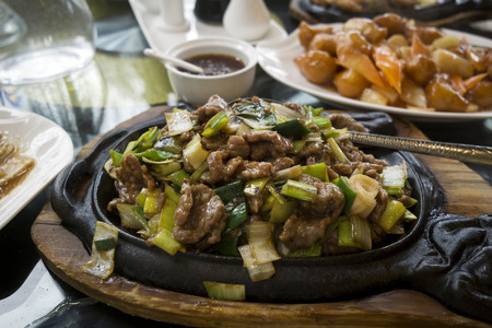 chops: Chinese food - stir fry beef with vegetables sauce.