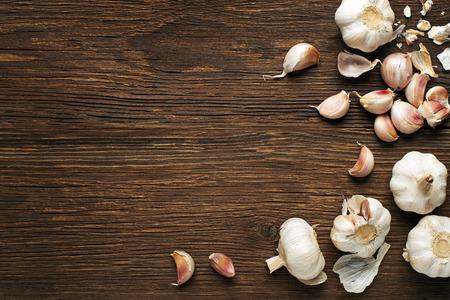 clove of clove: Garlic cloves on a vintage wooden background.