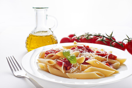 pasta sauce: Plate of penne pasta with tomato sauce and parmesan cheese.