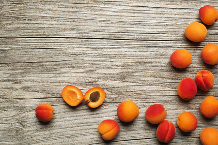 apricot kernel: Fresh cut apricot fruits on wooden background