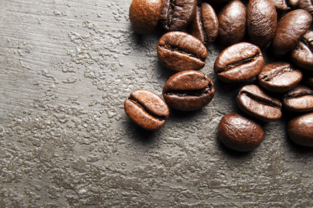 tropical shrub: Coffee beans on a grunge background close up. Stock Photo