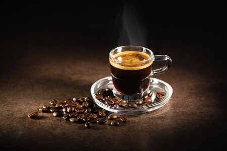 espresso cup: Cup of espresso coffee on dark background. Stock Photo