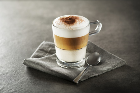 Glass of hot Latte macchiato coffee close up. Stockfoto