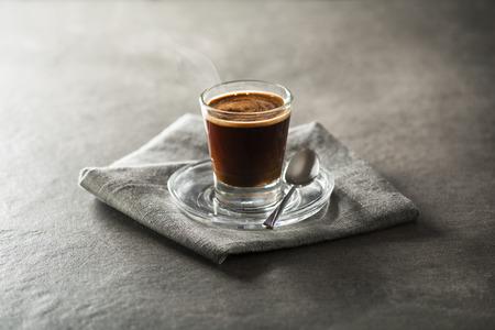 aromas: Cup of espresso coffee on dark background. Stock Photo