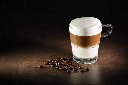 Glass of hot Latte macchiato coffee close up 写真素材