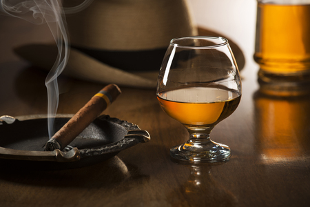 liquors: Whiskey,  brandy and cigar on wooden background