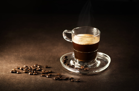 glass cup: Cup of espresso coffee on dark background. Stock Photo