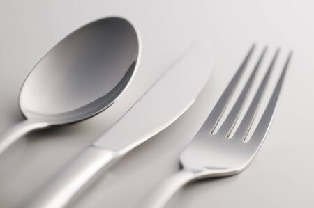fork and knife: Silverware: fork, knife and spoon on white background Stock Photo