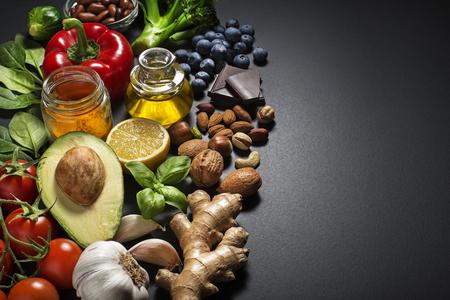Mixed fresh healthy food on dark background Archivio Fotografico
